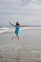 Child jumping on the beach, New Jersey