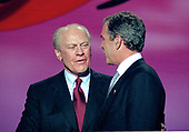 Former United States President Gerald R. Ford, left, and Governor George W. Bush (Republican of Texas), right, on the podium at the 1996 Republican National Convention at the San Diego Convention Center in San Diego, California on August 12, 1996.  <br /> Credit: Ron Sachs / CNP