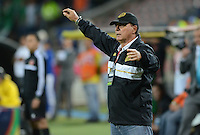 MEDELLÍN -COLOMBIA-25-10-2014. Oscar Quintabani técnico de Aguilas Pereira durante partido con Atlético Nacional por la fecha 16 de la Liga Postobón II 2014 jugado en el estadio Atanasio Girardot de la ciudad de Medellín./ Oscar Quintabani coach of Aguilas Pereira gestures during the match against Atletico Nacional for the 16th date of the Postobon League II 2014 at Atanasio Girardot stadium in Medellin city. Photo: VizzorImage/Luis Ríos/STR