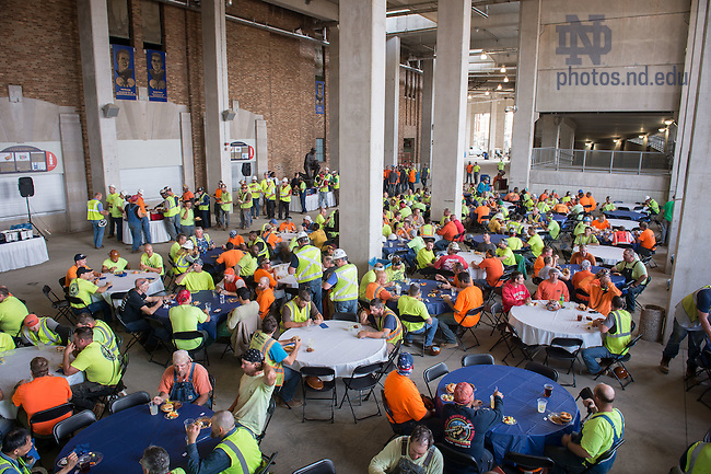 Jul. 2, 2015; Campus Crossroads construction workers enjoy a lunch provided by the University. (Photo by Matt Cashore/University of Notre Dame)