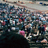 Detail of crowd far left. A slice of the full Interior of the Venue before the start of the Grateful Dead in Concert at the Carrier Dome, Syracuse University, New York on the 20th of October 1984. Photographed Dead Center Rear view Forward.