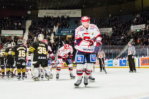 Stockholm 2014-12-01 Ishockey Hockeyallsvenskan AIK - S&ouml;dert&auml;lje SK :  <br /> S&ouml;dert&auml;ljes Jacob Dahlstr&ouml;m deppar efter matchen mellan AIK och S&ouml;dert&auml;lje SK <br /> (Foto: Kenta J&ouml;nsson) Nyckelord:  AIK Gnaget Hockeyallsvenskan Allsvenskan Hovet Johanneshov Isstadion S&ouml;dert&auml;lje SSK depp besviken besvikelse sorg ledsen deppig nedst&auml;md uppgiven sad disappointment disappointed dejected