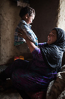 Hamina plays with Madi, her youngest child, Yekalong, Afghanistan, 10th November 2017. <br /> <br /> Hamina joue avec son plus jeune fils Madi, Yekalong, Afghanistan, 10 novembre 2017.