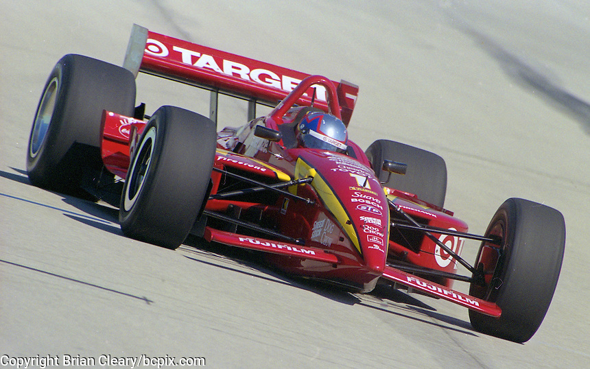 Juan Montoya races to a 23rd place finish in his Chip Ganassi Racinf  Lola B2K/00/Toyota  at the Homestead-Maimi Speedway, Homestead, FL, during the Marlboro Grand Prix of Miami CART Indy Car race, March 26, 2000.  (Photo by Brian Cleary/www.bcpix.com)