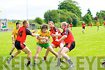 Dan Murphy (Gneenveguilla) in action with Danny Wrenn, Donal Leahy and Kevin Wrenn (Tarbert) in the County Senior League at Tarbert GAA Grounds on Sunday.