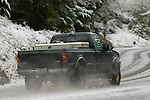 Ford F250 driving on a snowy road