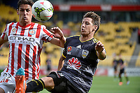 Nathan Burns and Ross Archibald in action during the A League - Wellington Phoenix v Melbourne City at Westpac Stadium, Wellington, New Zealand on Sunday 30 November 2014.