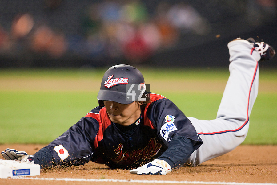 17 March 2009: #23 Norichika Aoki of Japan slides back to first base during the 2009 World Baseball Classic Pool 1 game 4 at Petco Park in San Diego, California, USA. Korea wins 4-1 over Japan.