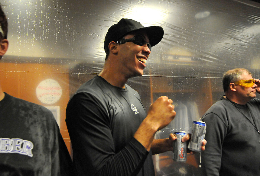01 October 2009: Rockies starting pitcher Ubaldo Jimenez looks for a target to drench with two full beers while celebrating after the final regular season home game at Coors Field between the Milwaukee Brewers  and the Colorado Rockies at Coors Field in Denver, Colorado. The Rockies beat the Brewers 9-2 and clinched a playoff berth via the National League Wild Card with the win.  *****For Editorial Use Only*****