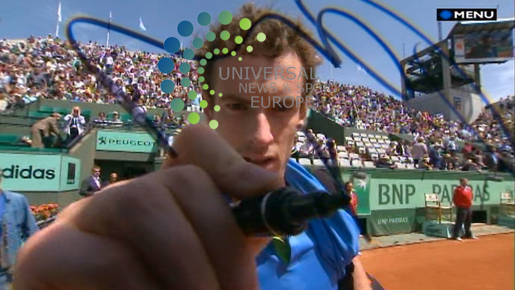 Andy Murray of Scotland signs a Eurosport camera lens, the fourth-seeded Briton reached the second round of the French Open with a 6-4, 6-1, 6-3 win over French qualifier Eric Prodon..Picture: Eurosport/Universal News And Sport (Scotland) 24 May 2011..(Universal News does not claim any Copyright or License in the attached material. Any downloading fee charged by Universal News and Sport is for Universal News services only. We are advised that screen Image's should not be used more than 48 hours after the time of original transmission, without the consent of the copyright holder)..