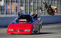 Nov 11, 2010; Pomona, CA, USA; NHRA funny car driver Gary Densham deploys his parachutes during qualifying for the Auto Club Finals at Auto Club Raceway at Pomona. Mandatory Credit: Mark J. Rebilas-