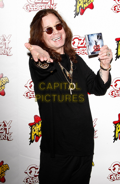 OZZY OSBOURNE.Ozzy Osbourne signing his new album 'Scream', Amoeba Music, Los Angeles, California, USA..June 20th, 2010.half length black top sunglasses shades hand gold necklaces.CAP/PE.©Peter Eden/Capital Pictures.