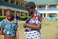 TANZANIA Mara, Tarime, village Masanga, region of the Kuria tribe who practise FGM Female Genital Mutilation, temporary rescue camp of the Diocese Musoma for girls which escaped from their villages to prevent FGM / TANSANIA Mara, Tarime, Dorf Masanga, in der Region lebt der Kuria Tribe, der FGM weibliche Genitalbeschneidung praktiziert, temporaerer Zufluchtsort fuer Maedchen, denen in ihrem Dorf Genitalverstuemmelung droht, in einer Schule der Dioezese Musoma, REGINA ANDREA MUKAMA genannt MAMA REGINA MARIA MAGABE (das junge Mädchen, das beschnitten wurde)