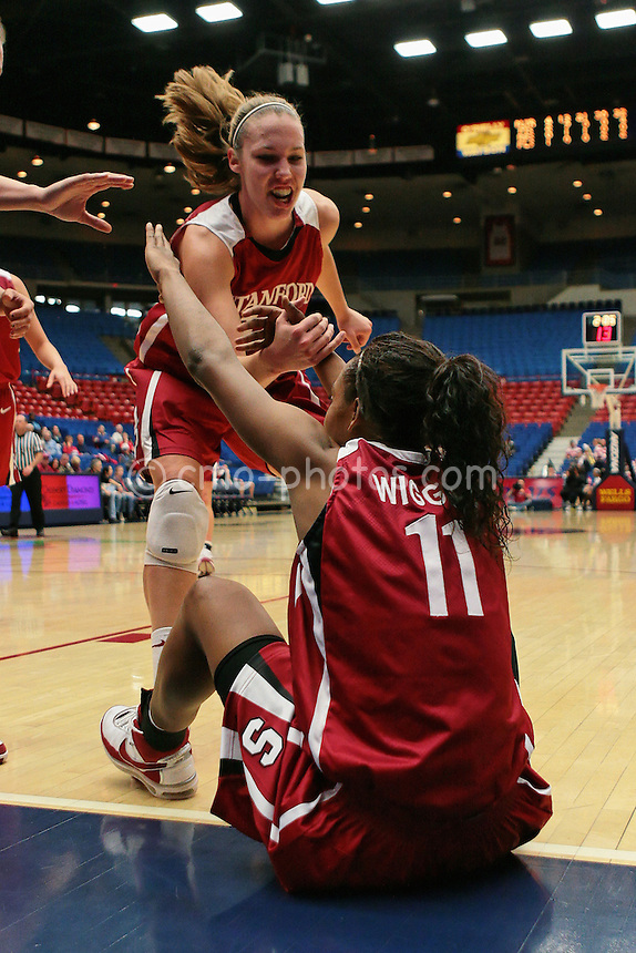 Jan 17, 2008; Tucson, AZ, USA; Teammates help Stanford Cardinal guard Candice Wiggins up off the floor during a game aganist the Arizona Wildcats at the McKale Center.  The Cardinal won the game 89-64.