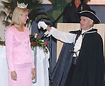 Dan Irving/The Holland Sentinel.Holland Town Crier John Karsten, right, announces the arrival of Miss America Kirsten Haglund during the Tulip Time Festival Luncheon Wednesday at the Hope College Dow Center..(5/7/08)