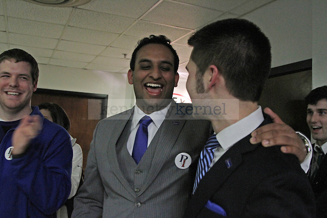 Roshan Palli and Jake Ingram celebrate after their win for  president and vice president after the Student Government position announcement at the Student Center in Lexington, Ky., on Thursday, February 28, 2013. Photo by Genevieve Adams | Staff