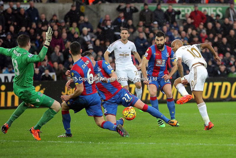 (L-R) Wayne Hennessey, Scott Dann and Damien Delaney of Crystal Palace block a shot by Andre Ayew of Swansea during the Barclays Premier League match between Swansea City and Crystal Palace at the Liberty Stadium, Swansea on February 06 2016