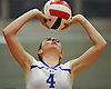 Megan Pfundstein #4 of Kellenberg makes a set during a CHSAA varsity girls volleyball match against host Sacred Heart Academy in Hempstead on Tuesday, Oct. 4, 2016. Kellenberg won the match 3-0.