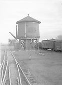 D&amp;RGW Antonito water tank south side.  The coaling trestle is in the far distance.<br /> D&amp;RGW  Antonito, CO  Taken by Rogers, Donald E. A. - 12/1937