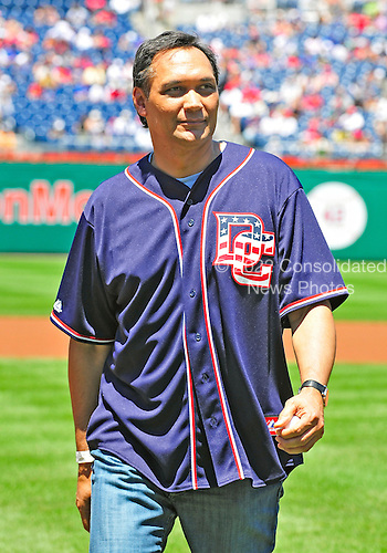Actor Jimmy Smits leaves the field after throwing out the ceremonial first pitch prior to the New York Mets against the Washington Nationals game at Nationals Park in Washington, D.C. on Sunday, July 4, 2010.  .Credit: Ron Sachs / CNP.(RESTRICTION: NO New York or New Jersey Newspapers or newspapers within a 75 mile radius of New York City)