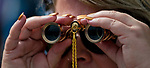 HALLANDALE BEACH, FL - JANUARY 27: A woman views the race through binoculars on Pegasus World Cup Invitational Day at Gulfstream Park Race Track on January 27, 2018 in Hallandale Beach, Florida. (Photo by Scott Serio/Eclipse Sportswire/Getty Images)