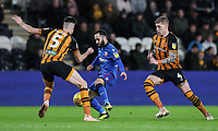 Bolton Wanderers' Erhun Oztumer competing with Hull City's Reece Burke and Jordy de Wijs<br /> <br /> Photographer Andrew Kearns/CameraSport<br /> <br /> The EFL Sky Bet Championship - Hull City v Bolton Wanderers - Tuesday 1st January 2019 - KC Stadium - Hull<br /> <br /> World Copyright © 2019 CameraSport. All rights reserved. 43 Linden Ave. Countesthorpe. Leicester. England. LE8 5PG - Tel: +44 (0) 116 277 4147 - admin@camerasport.com - www.camerasport.com