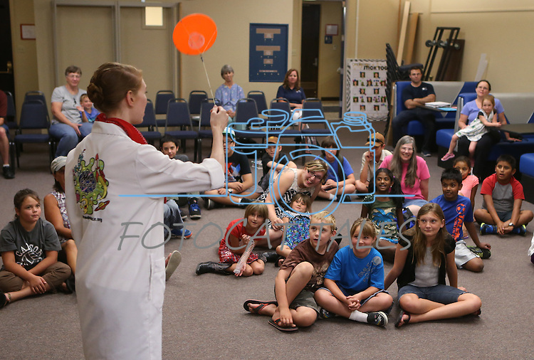 Radioactive Rachel demonstrates centripetal force during the Mad Science program at the Carson City Library, in Carson City, Nev., on Tuesday, July 15, 2014.<br /> Photo by Cathleen Allison