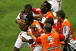 01 July 2006: France substitutes mob Thierry Henry (FRA) (ducking, head farthest left) after his 57th minute goal. France defeated Brazil 1-0 at Commerzbank Arena in Frankfurt, Germany in match 60, a Quarterfinal game of the 2006 FIFA World Cup.