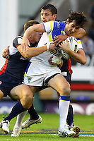 PICTURE BY ALEX WHITEHEAD/SWPIX.COM - Rugby League - Super League Play-Off - Warrington Wolves vs St Helens - The Halliwell Jones Stadium, Warrington, England - 15/09/12 - Warrington's Stefan Ratchford is tackled by St Helens' James Roby and Jon Wilkin.