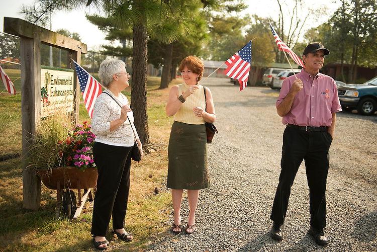 "UNITED STATES - SEPTEMBER 23:  Local residents from left,  Margi Wallo, Megan Albright, and Mike Panchura, greet members of Congress and media outside of Tart Lumber Company in Sterling, Va.  House Minority Leader John Boehner, R-Ohio, and republican leaders chose this location to unveil ""A Pledge to America,"" a new governing agenda for the 111th Congress. (Photo By Tom Williams/Roll Call via Getty Images)"