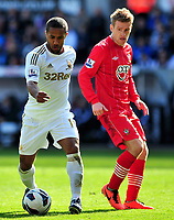 Pictured: Wayne Routledge. (L).<br /> Saturday 20 April 2013<br /> Re: Barclay's Premier League, Swansea City FC v Southampton at the Liberty Stadium, south Wales.