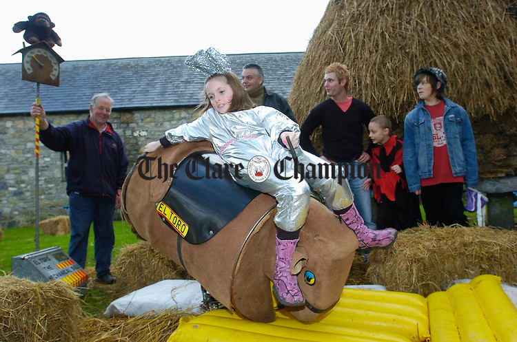 Ruth Cusack hangs on in there during the Halloween Festivities at Bunratty Folk Park. Photograph by John Kelly.
