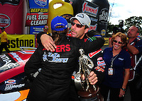 Aug. 21, 2011; Brainerd, MN, USA: NHRA pro stock driver Greg Anderson is congratulated by Erica Enders after winning the Lucas Oil Nationals at Brainerd International Raceway. Mandatory Credit: Mark J. Rebilas-