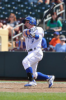 Johnny Giavotella #9 of the Omaha Storm Chasers swings against the Las Vegas 51s at Werner Park on August 17, 2014 in Omaha, Nebraska. The Storm Chasers  won 4-0.   (Dennis Hubbard/Four Seam Images)