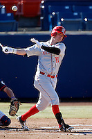 Rich Sanguinetti #11 of the Nebraska Cornhuskers bats against the Cal State Fullerton Titans at Goodwin Field on February 16, 2013 in Fullerton, California. Cal State Fullerton defeated Nebraska 10-5. (Larry Goren/Four Seam Images)
