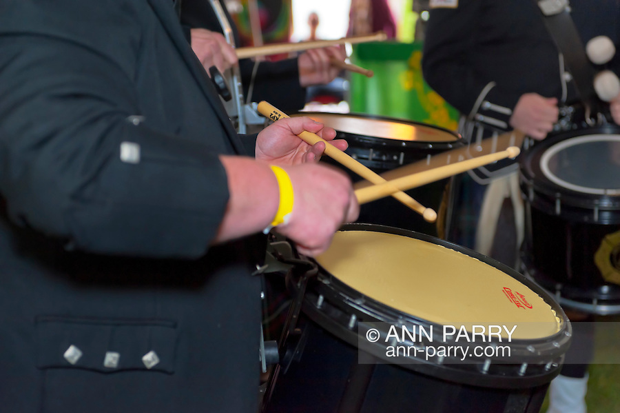 Fund raiser for firefighter Ray Pfeifer on Saturday, March 31, 2012, at East Meadow Firefighters Benevolent Hall, New York, USA. The Boston Gaelic Fire Brigade Pipes and Drums band performed, a drum being played seen in closeup.