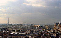 Paris: Looking west from Beaubourg at dusk. Eiffel Tower in back left.