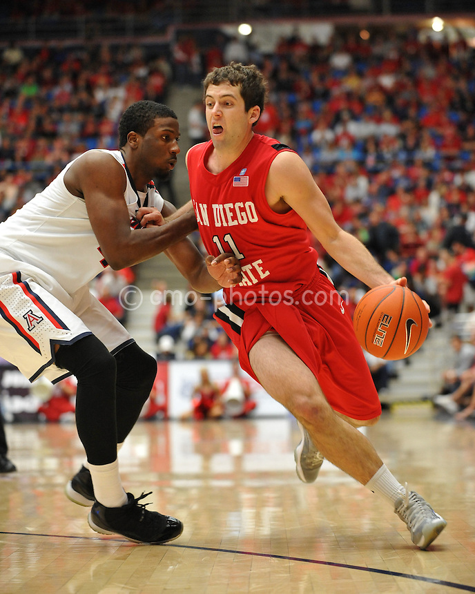 Nov 23, 2011; Tucson, AZ, USA; San Diego State Aztecs guard James Rahon (11) dribbles the ball around Arizona Wildcats forward Solomon Hill (44) in the second half of a game at the McKale Center.  The Aztecs won 61-57.  Mandatory Credit: Chris Morrison-US PRESSWIRE