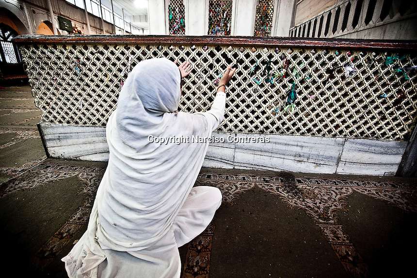 Kashmri muslim woman cries as she prays at a shrine of a sufi saint in Srinagar as the main duty to observe the holy month of Ramadan. As the tradition is attended muslims has to fast from dawn to dusk, where they refrain from eating, drinking and smoking..