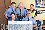 Norma Lynch Special Olympics Co-Ordinator being presented with a cheque for over 5,000 euros by John Kerin Chief Supt Tralee Gardai..Back Row: Garda Ricky Galvin, Caherciveen, Sgt Tom Tobin, Killarney, and Garda Emma Mullane, Tralee Missing from photo is Garda Shane O'Driscoll, Listowel.