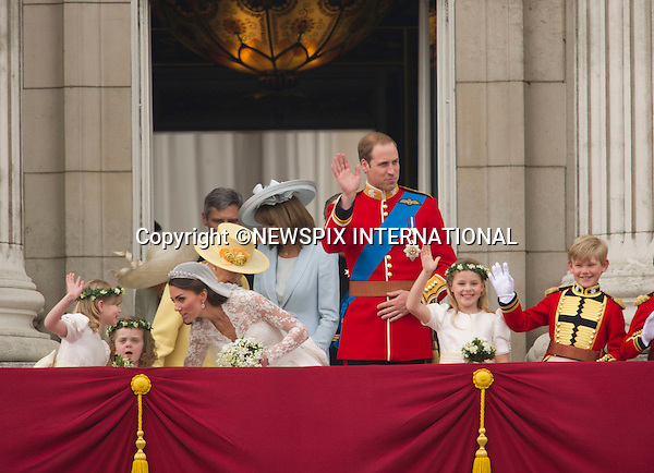 "Prince William and Catherine Middleton Kiss on the Buckingham Palace Balcony and and arrive in Carriages to Buckingham palace.THE ROYAL WEDDING.Prince William and Catherine Middleton delight the crowds with a kiss..The Newly married coupleThe Duke and Duchess of Cambridge take in the splendor of the crowds from the balcony of Buckingham Palace..Prince William and Catherine Middleton marry at Westminster Abbey..The Duke and Duchess of Cambridge London_29/04/2011.Mandatory Photo Credit: ©Dias/Newspix International..**ALL FEES PAYABLE TO: ""NEWSPIX INTERNATIONAL""**..PHOTO CREDIT MANDATORY!!: NEWSPIX INTERNATIONAL(Failure to credit will incur a surcharge of 100% of reproduction fees)..IMMEDIATE CONFIRMATION OF USAGE REQUIRED:.Newspix International, 31 Chinnery Hill, Bishop's Stortford, ENGLAND CM23 3PS.Tel:+441279 324672  ; Fax: +441279656877.Mobile:  0777568 1153.e-mail: info@newspixinternational.co.uk"