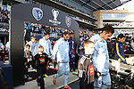 07 December 2013: Kansas City's Benny Feilhaber (right) marches onto the field followed by Graham Zusi, Matt Besler, and Seth Sinovic. MLS Cup 2013 was played between Sporting Kansas City and Real Salt Lake at Sporting Park in Kansas City, Kansas. Sporting Kansas City won the championship by winning the penalty kick shootout 7-6 after the game ended in a 1-1 tie.