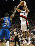 04/03/11--Blazers' Brandon Roy shoots over Mavericks' Jason Terry in the first half at the Rose Garden in Portland, Or.. Portland defeated Dallas 104-96..Photo by Jaime Valdez........................................