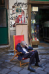 Morning Riposo. Shopkeeper in Vicolo Mezzani, Palermo, Italy.