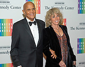 Harry Belafonte and his wife, Pamela, arrive for the formal Artist's Dinner honoring the recipients of the 2013 Kennedy Center Honors hosted by United States Secretary of State John F. Kerry at the U.S. Department of State in Washington, D.C. on Saturday, December 7, 2013. The 2013 honorees are: opera singer Martina Arroyo; pianist,  keyboardist, bandleader and composer Herbie Hancock; pianist, singer and songwriter Billy Joel; actress Shirley MacLaine; and musician and songwriter Carlos Santana.<br /> Credit: Ron Sachs / CNP