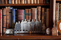 A paper cut out of the Lygon family in the early 1920s displayed in the library. From left ot right: Coote, Maimie, Sibell, Lettice, Lady Beauchamp, 7th Earl Lord Beauchamp, Elmley, Hugh and Dickie