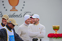 Brandon Grace (RSA) and Louis Oosthuizen (RSA) share a laugh on the first tee during round 3 Foursomes of the 2017 President's Cup, Liberty National Golf Club, Jersey City, New Jersey, USA. 9/30/2017.<br /> Picture: Golffile | Ken Murray<br /> <br /> All photo usage must carry mandatory copyright credit (&copy; Golffile | Ken Murray)