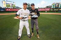 Andy Yerzy (15) of York Mills Collegiate Institute in Toronto, Ontario and Carter Kieboom (22) of Walton High School in Marietta, Georgia pose with their teams respective Most Valuable Player Award after the Under Armour All-American Game on August 15, 2015 at Wrigley Field in Chicago, Illinois. (Mike Janes/Four Seam Images)