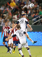 Revolution midfielder Pat Phelan (28) heads the ball during the first half of the game between Chivas USA and the New England Revolution at the Home Depot Center in Carson, CA, on September 10, 2010. Chivas USA 2, New England Revolution 0.