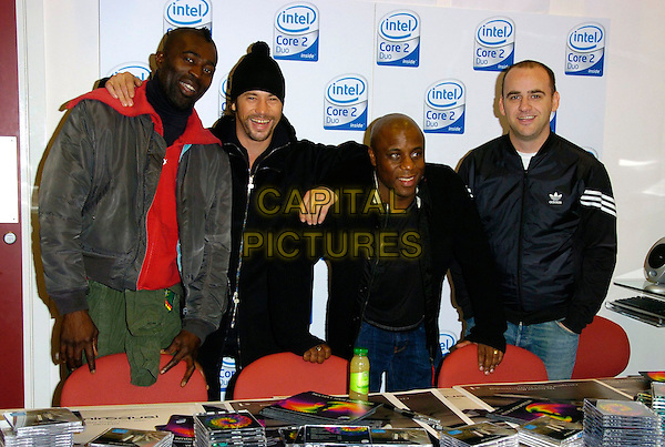 JAY KAY & JAMIROQUI.At the Jamiroquai album Launch & CD Signing, PC World,.Tottenham Court Road, London, England,.November 18th 2006..half length music band group hat.CAP/CAN.©Can Nguyen/Capital Pictures